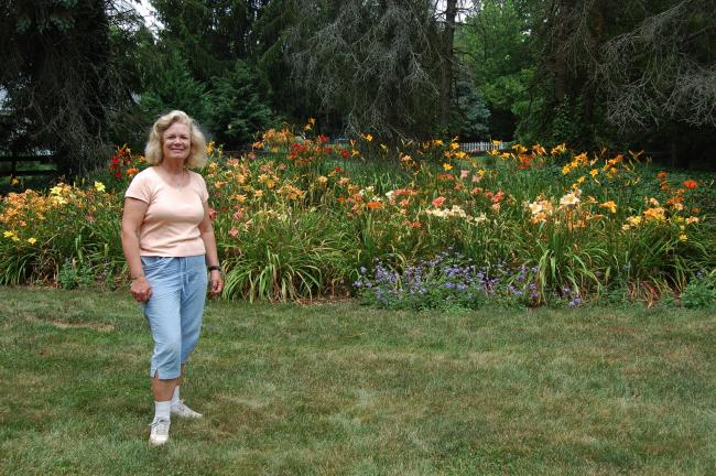 ELSA KERSCHNER/TIMES NEWS Celie Turner enjoys the day lilies planted where they can be seen when visitors come in the driveway.