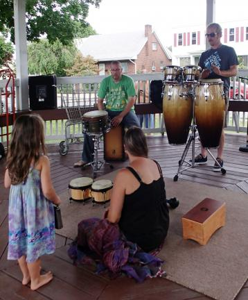 AL ZAGOFSKY/SPECIAL TO THE TIMES NEWS Franklin Klock (left) and Jamie Huber demonstrate drumming at last week's Summit Hill festival.