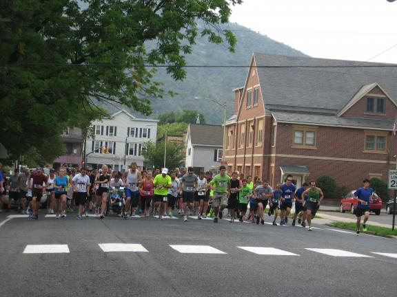 STACEY SOLT/SPECIAL TO THE TIMES NEWS Runners in the 5th annual Palmerton 5K for Diabetes begin the race on Third Street. There were 96 runners and walkers in this year's event, which raised $2,600.