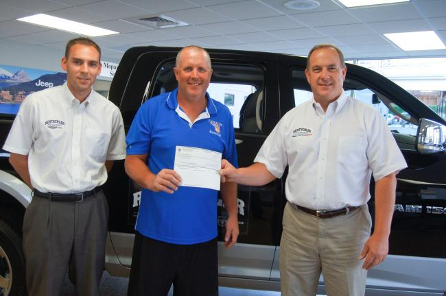 TERRY AHNER/TIMES NEWS Rentschler Chrysler-Jeep-Dodge-Ram, of Slatington, recently presented a check in the amount of $2,300 to the Palmerton High School Basketball Parents' Club, which hosted a Dodge Booster Club fundraiser as part of the PHS…
