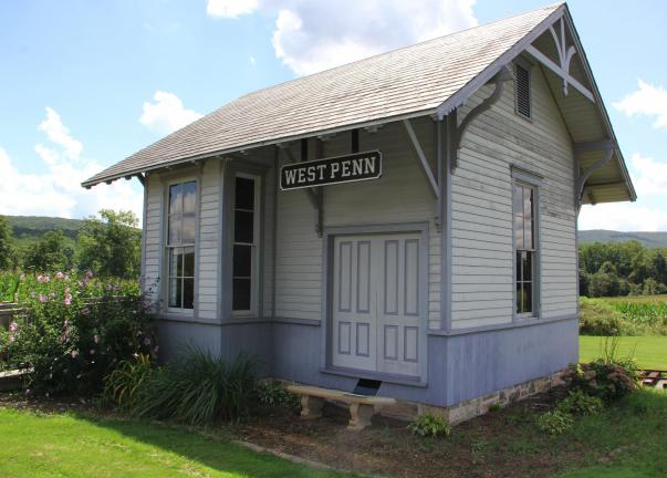 ANDREW LEIBENGUTH/TIMES NEWS West Penn's Depot Station, which is located next to the Sovereign Bank along SR309 in Snyders (West Penn Township) was recognized by a number of local and area enthusiasts and historians for surviving 100 years.