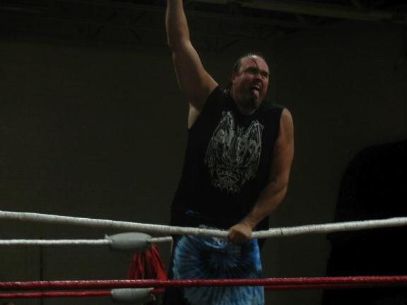CAROL ZICKLER/SPECIAL TO THE TIMES NEWS Standing alone to defend his title is Gene Snisky at the American Cancer Society's Carbon Tamaqua unit WXWC4 wrestling event at Panther Valley High School.
