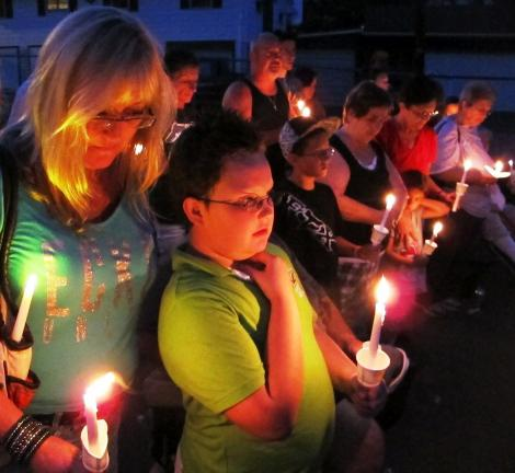 ANDREW LEIBENGUTH/TIMES NEWS Blake Bowers, 9, Seth Valentine's son, stands with his grandmother Kim Johnson during the vigil.