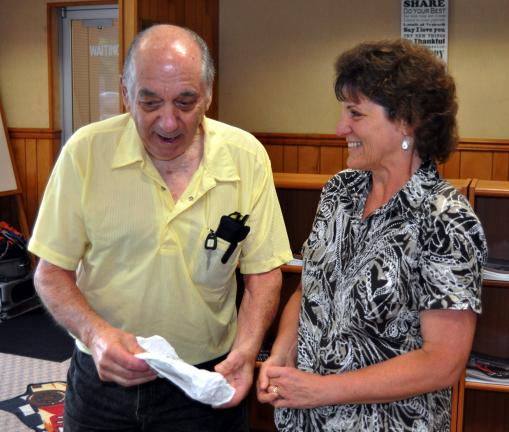 DONALD R. SERFASS/TIMES NEWS Charles, an 81-year-old resident of Andreas, arrives in Lehighton on Thursday morning to show Crystal Bauchspies a frozen food wrapper, attesting to his visit Wednesday to a freezer case at Giant Food Store.