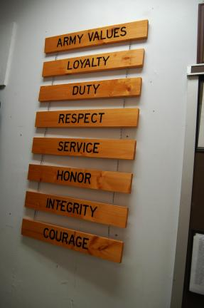 Wooden plaques carved with U.S. Army values are posted in the entrance of the Panther Valley High School's Junior Reserve Officer Training Corps classroom.