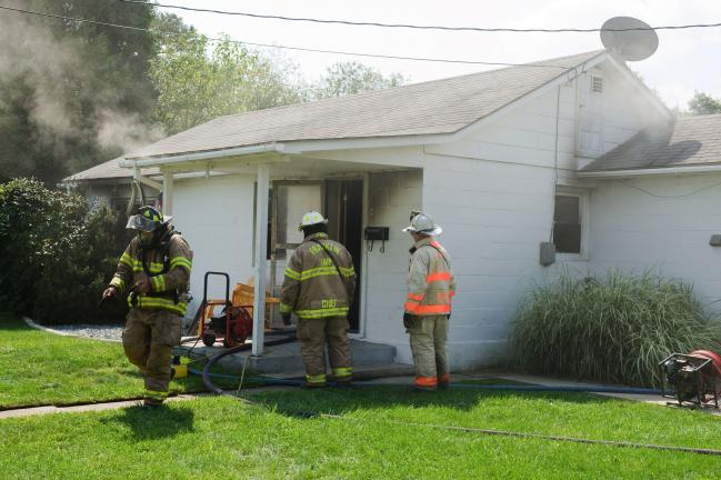 Bob Ford/TIMES NEWS Franklin Township and Lehighton firefighters quelled a smokey blaze at 316 Held St., Lehighton, in the Union Hill section of Franklin Township.