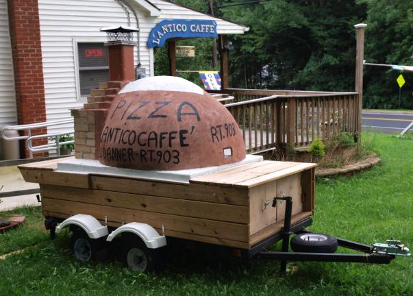 AL ZAGOFSKY/SPECIAL TO THE TIMES NEWS Giuseppe Puddu's wood-fired brick pizza oven on wheels is parked beside his L'antico Caffé Italian cafe in the Penn Forest Township suburb of Jim Thorpe.