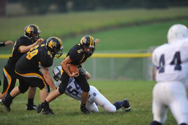 NANCY SCHOLZ/Special to THE TIMES NEWS Northwestern's Dylan Snyder tries to slip the tackle of Salisbury's Tyler Waterman.