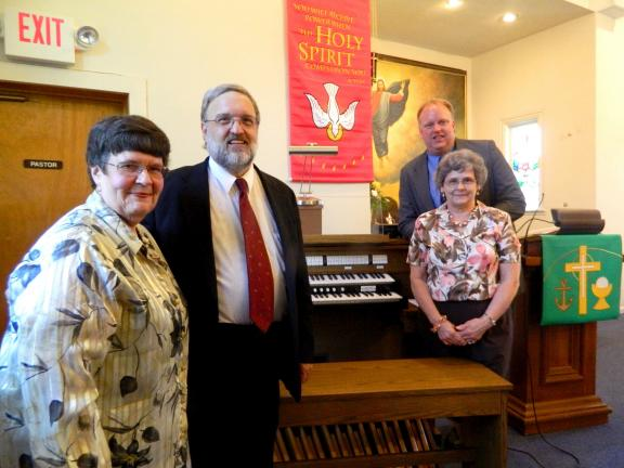 JUDY DOLGOS-KRAMER/SPECIAL TO THE TIMES NEWS Cathy Fitting, Randal Perry, Shirley Leinthall and Pastor Doug Holtz at the dedication of the new organ at St. Paul's in Albrightsville.