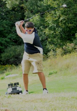 ron gower/times news Tamaqua's Matt Stanek prepares to his tee shot at Villas Crossing Golf Course.