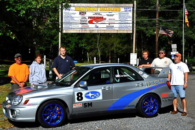 VICTOR IZZO/SPECIAL TO THE TIMES NEWS Gathered around the race car of sponsor Fairway Subaru of Hazleton prior to this weekend's Weatherly Hill Climb are, left to right : Wayne Gettig, Weatherly Hill Climb Association; Janet Gettig, Weatherly Hill…