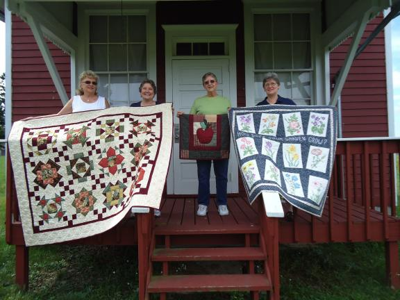 SPECIAL TO THE TIMES NEWS Preparing for the Historic Brainerd Church Festival are members of the Cranberry Quilt Guild, from left Judy Yeager, chairwoman; Debbie Kessell, guild president; Linda Webster and Betty Rosato. The guild will display…