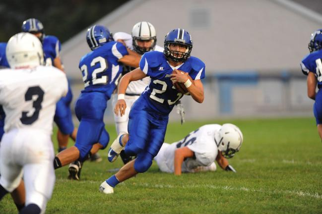 nancy scholz/times news Palmerton's Alex Vignone finds running room against Salisbury. The Bombers' Trey Nelson (22) is providing a block in the background
