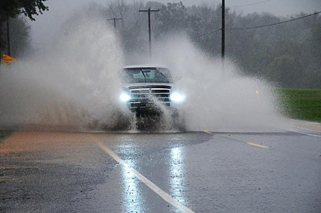 Larry Neff/special to the times news Motorists had a tough time traveling Route 443 in Mahoning Township after heavy rains flooded the busy roadway Tuesday afternoon.