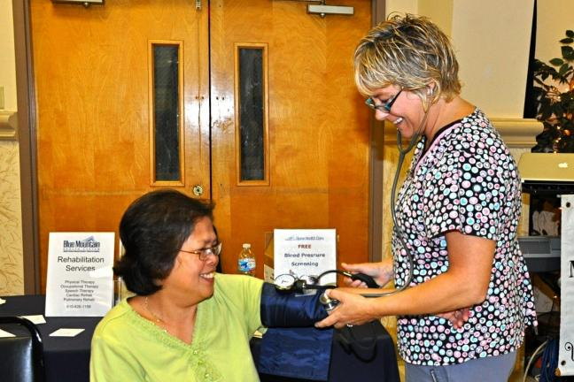 Lily Evans of Lehighton has her blood pressure checked by Lisa Pompa, Supervisor Cardiac Rehab at Blue Mountain Health System during the Senior Citizens Expo.