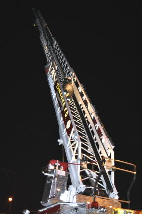 Darren Amos of Middleport Fire Company climbs 100 feet into the darkness in downtown Tamaqua late Wednesday as part of aerial training.