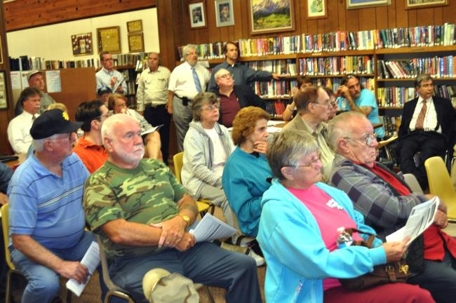 DONALD R. SERFASS/TIMES NEWS  A portion of the crowd at the Tamaqua Public Library on Thursday listens to an update on the status of a rare blood disease found in the local area in 2004.