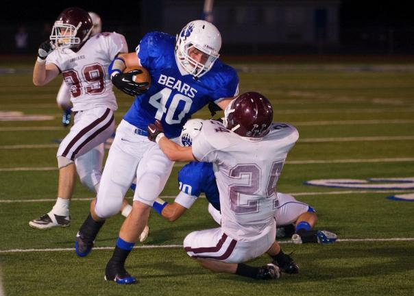 Bob Ford/TIMES NEWS Pleasant Valley's Dakota Everett tries to get past Nick Newton of Lehighton during Friday's game in Brodheadsville.