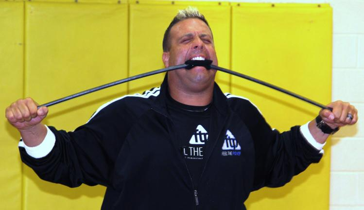 ANDREW LEIBENGUTH/TIMES NEWS Guinness Book of World Record holder Jon Pritikin bends a metal pipe during presentations held at numerous Tamaqua Area schools.