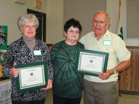 STACEY SOLT/SPECIAL TO THE TIMES NEWS Members of the 4-H community recently gathered to celebrate 100 years of 4-H in Pennsylvania. The oldest members attending the event were Louise Reitz, left, 85, and John Gregory, right, 78. Center is Georgia…