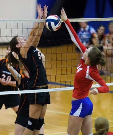 bob ford/times news Weatherly's Lindsay Douglas (left) goes up to block a hit by and Jim Thorpe's Makenzie Walck