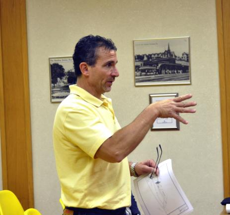 Jeff Bonacci, representing Day Job Property Management Corporation, tells Tamaqua's Historic Architectural Review Commission members Monday that the former Napoli building could be torn down by Christmas.