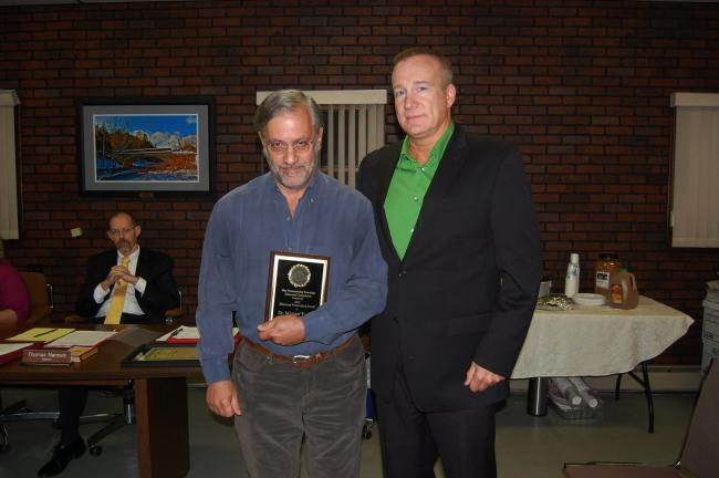 ELSA KERSCHNER/TIMES NEWS Towamensing Township Historical Commission chairman Karl Rolappe presents the Historic Preservation award to Dr. Michael Touger for restoring his barn. The presentation was made at the Oct. 4 supervisors' meeting.