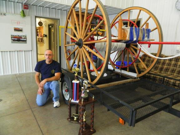JUDY DOLGOS-KRAMER/SPECIAL TO THE TIMES NEWS Stephen Lilick is pictured beside his Wirt-Knox Hose Cart. The cart from 1860 took first place at the Pennsylvania Firemen's Convention in Norristown on Sept. 29.