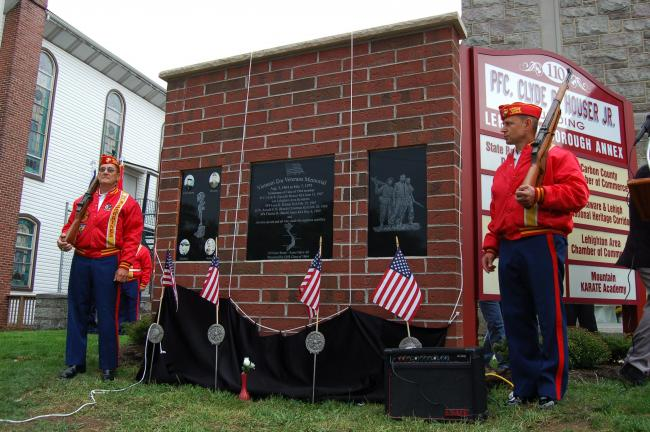 Gail Maholick/TIMES NEWS Members of the Lehighton United Veterans Organization unveil the Vietnam Veterans Memorial during a dedication program held Saturday at the Pfc. Clyde R. Houser Jr. Borough Annex Building on North Third Street in Lehighton…