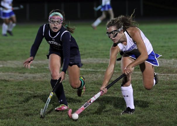 rich George/special to the times news Palmerton's Jessica Pereira (right) tries to protect the ball as Northern Lehigh's Lauren Zellner reaches in.