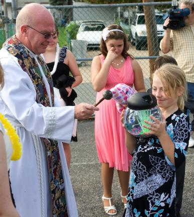 BOB FORD/TIMES NEWS The Rev. Michael Ahrensfield blesses fifth grader Amber Curran's fish during Ss. Peter and Paul School's annual pet blessing last week. Each year the school holds a pet blessing for both live and stuffed pets in conjunction with…