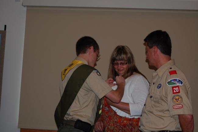 ELSA KERSCHNER/TIMES NEWS Aleksander Everett pins the Eagle mother's pin on Julie Everett's blouse.