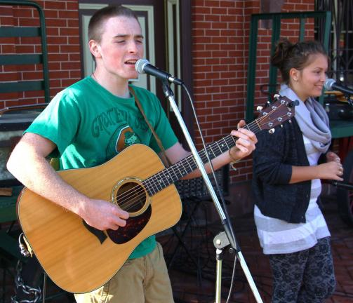 Shane McGeehan, left, and Olivia Morrison perform outside the train station during the festival.