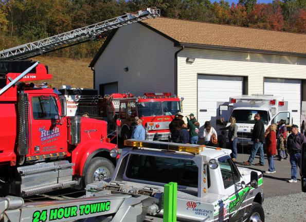 ANDREW LEIBENGUTH/TIMES NEWS All types of trucks surrounded the West Penn Fire Company during there free community Touch-A-Truck event held over the weekend.