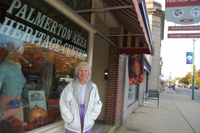TERRY AHNER/TIMES NEWS The Palmerton Area Historical Society has been selected as grand marshal for Palmerton's 21st annual Halloween Parade on Sunday. Pictured outside the Palmerton Area Heritage Center building is Betsy Burnhauser, a member of the…