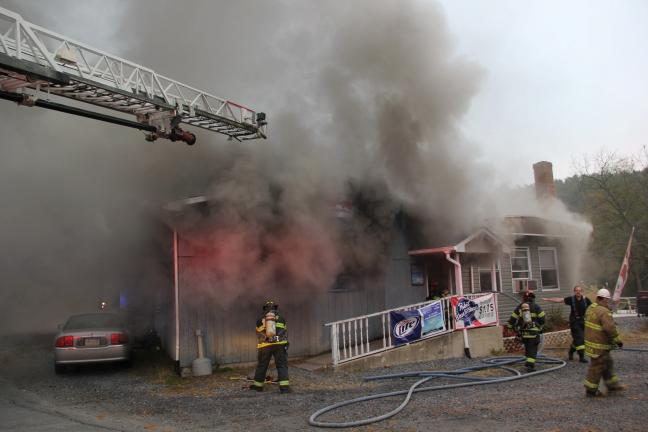 ANDREW LEIBENGUTH/TIMES NEWS Firefighters were quick to respond to a structure fire at the Carnes's Clamtown Tavern and Restaurant in Clamtown just before 7:30 this morning.