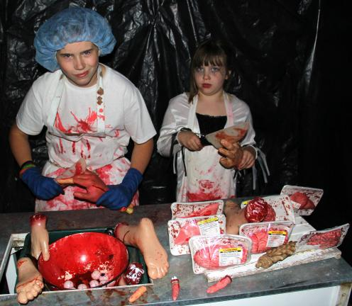 ANDREW LEIBENGUTH/TIMES NEWS Serving up livers and hearts are mad butchers Tommy Kleppinger, 13, and Kelsey Kraemer, 8.
