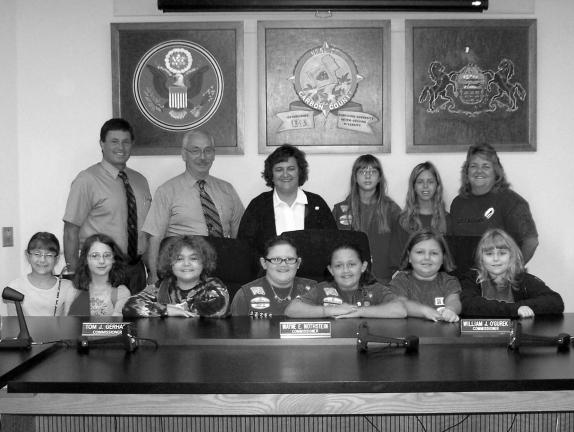 SPECIAL TO THE TIMES NEWS Visiting the Carbon County Commissioners' Office recently are the Weatherly Junior Girl Scout Troop. Pictured from left, front row, are Samantha Sparich, Lily Dennenbaum, Linsey Strouse, Amanda Colecio, Alexis Colecio,…