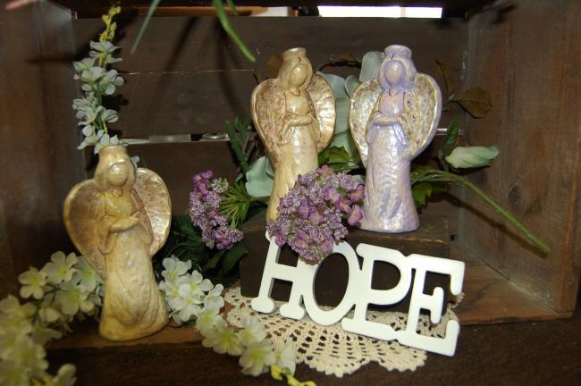 LINDA KOEHLER/TIMES NEWS Suzie Merwine of Effort makes these beautiful ceramic angels she calls her Angel of Hope.
