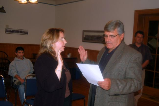 TERRY AHNER/TIMES NEWS Newly-appointed Palmerton Borough Councilwoman Holly Sell is sworn in by Mayor Chris Oliva on Thursday.