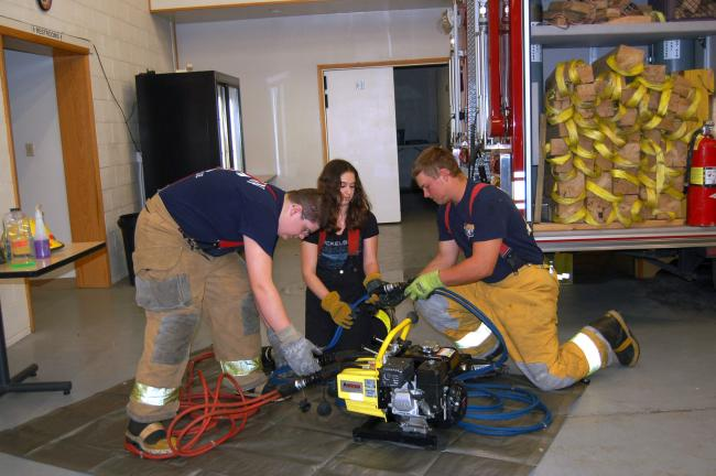CHRIS PARKER/TIMES NEWS Connor Evans, Emily Pratka and Steven Troxell, junior volunteer firefighters with West Penn Fire Co., practice swiftly assembling equipment.