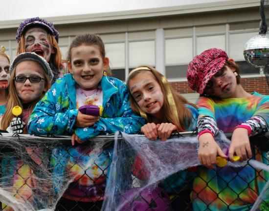 "SPECIAL TO THE TIMES NEWS Members of Girl Scout Troop 34289 proudly show off their costumes in their float themed, ""Disco Brownies."" The troop took 3rd place in the Float category."