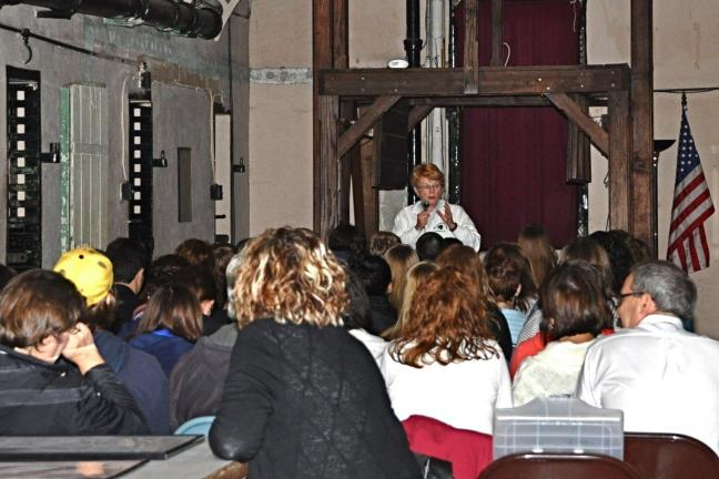 "VICTOR IZZO/SPECIAL TO THE TIMES NEWS During their visit to the Olde Jail Museum in Jim Thorpe, students participating in the LCIU ""Student Forum"" program listened intently to a talk by museum co-owner Betty Lou McBride about what being a business…"