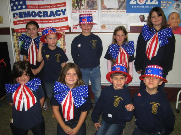 STACEY SOLT/SPECIAL TO THE TIMES NEWS ABOVE: First-grade students at SS. Peter and Paul School, Lehighton, wear patriotic attire during the quadrennial presidential election assembly. During the assembly, students learned about the election process…