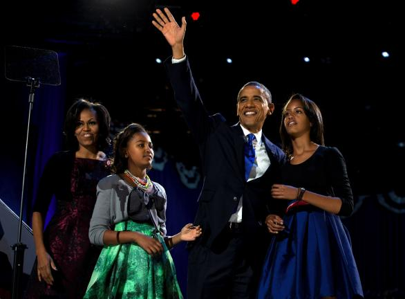 AP PHOTO President Barack Obama waves as he walks on stage with first lady Michelle Obama and daughters Malia and Sasha at his election night party in Chicago. Obama defeated Republican challenger former Massachusetts Gov. Mitt Romney.