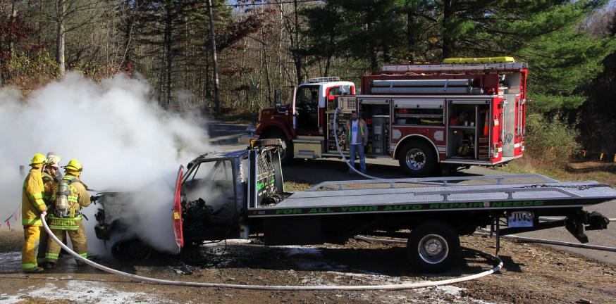 "ANDREW LEIBENGUTH/TIMES NEWS A flatbed tow truck owned by Ziegler's Auto Repair and Towing was gutted after it caught fire along Lumber Lane in West Penn Township yesterday afternoon. ""I grabbed a fire extingusher and tried to put the fire out, but…"