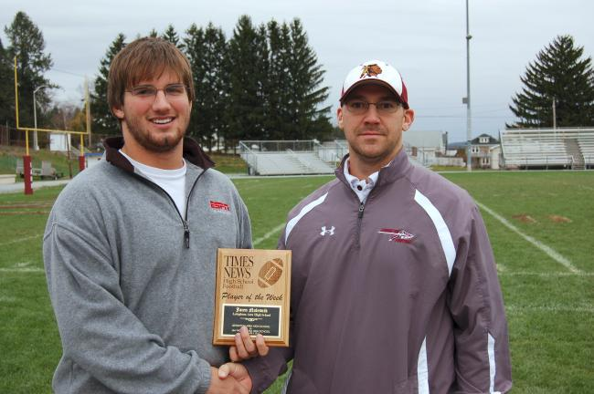brad hurley/times news Lehighton's Jacen Nalesnik is congratulated by head coach Tom McCarroll for winning the TIMES NEWS Player of the Week award. Nalesnik carried 21 times for 156 yards and two touchdowns last Saturday in a 27-6 win over Jim Thorpe.