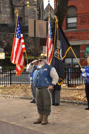 AMY MILLER/TIMES NEWS Sgt. John Gallagher, sergeant-at-arms and adjutant of American Legion Post 304 in Jim Thorpe, salutes during the singing of the National Anthem during the annual Carbon County Veterans Day program in Jim Thorpe.