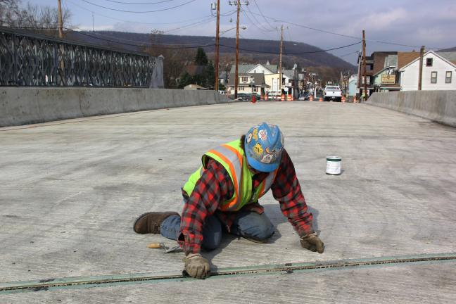 ANDREW LEIBENGUTH/TIMES NEWS Fourteen months after the start of PennDOT's Center Street bridge replacement project in Tamaqua, traffic will finally be allowed to drive on the newly constructed bridge starting some time this Thursday. This is seven…