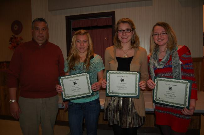 Penn State Cooperative Extension presented three Rachel W. Hoffmeier 4-H Scholarship awards at the annual banquet. From left are, Howard Gregory, president of the 4-H Development Advisory Committee; Courtney Getz of Palmerton; Elyse Kistler and…